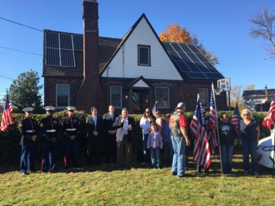 Dedication ceremony of the SUNation Cares donated solar system (from left to right: Marine Honor Guard, Senator Todd Kaminsky, Congressman Lee Zeldin, SUNation CEO Scott Maskin, Eileen Howell and family, Patriot Guard Riders)